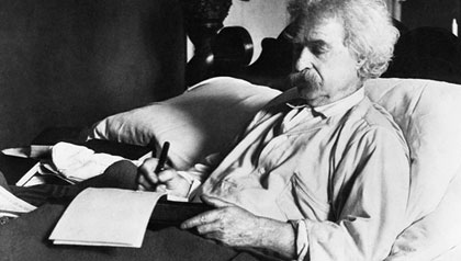 Mark Twain working in bed (Photo Credit: Corbis)